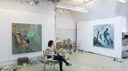 A photo of artist Inka Essenhigh in her studio