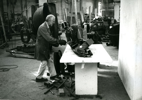A photograph of Anthony Caro working in his studio