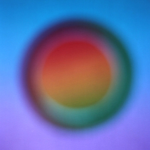 A photocollage of a circle with hazy colours