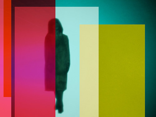 A photocollage of a shaded figure amid geometric planes of colour