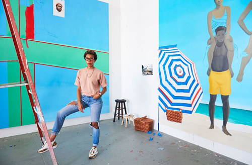 A photo of artist Amy Sherald at work in her studio