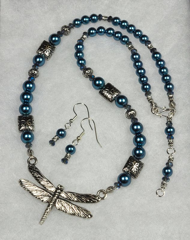Iris Blue crystal pearls with a Dragonfly focal. by Sue Ellen Brown