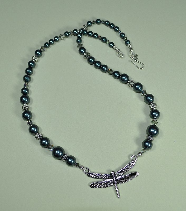 Swarovski Tahitian Blue crystal pearls and crystal beads with a Dragonfly focal. by Sue Ellen Brown