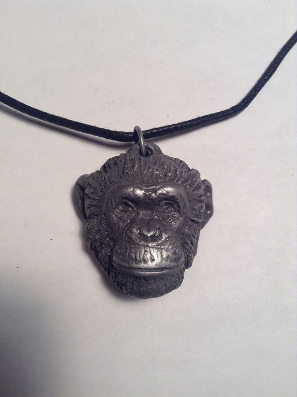 Topo chimps in pendant dark cold cast pewter by Jason  Shanaman