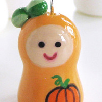 Painting Little Pumpkin. Karokeshi pendant charm series. by Carolina Seth