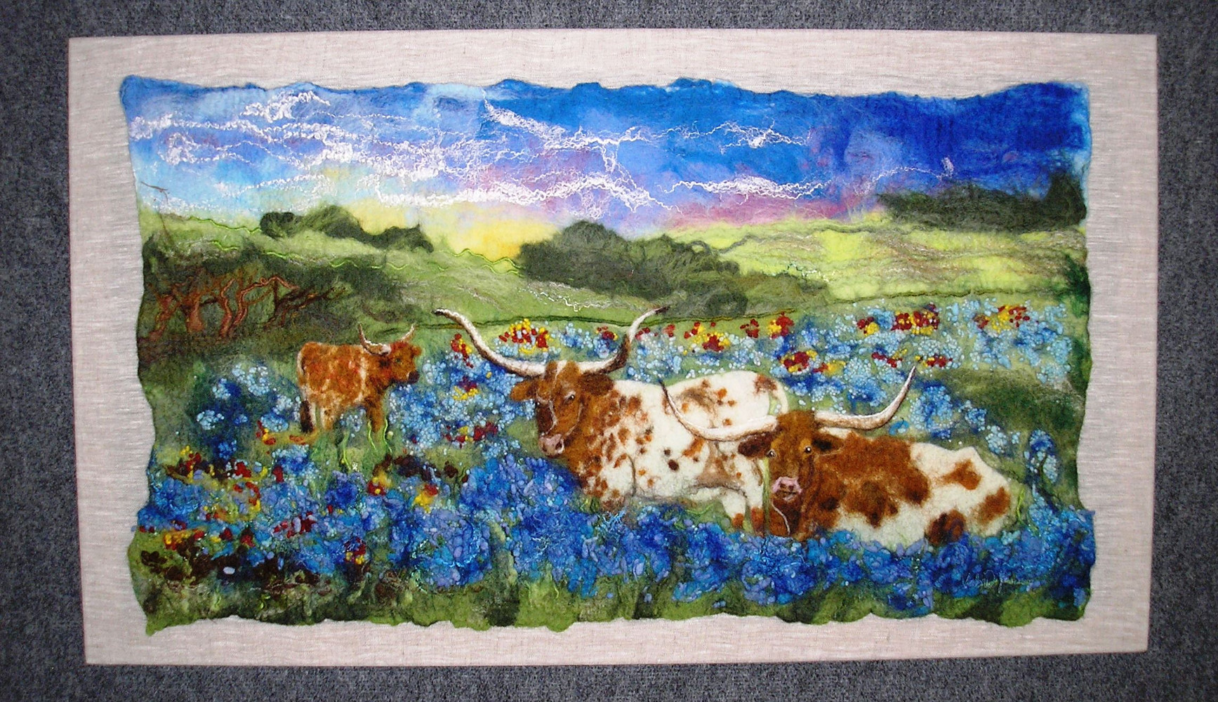 Longhorns in Blue bonnets by Valerie Johnson