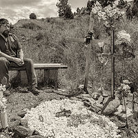 Frank Martinez with descanso for his son, Diego, Mora, NM. 2015 by Jim Holbrook