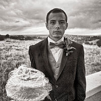 Man with Wedding Cake, Placitas, NM, 2014. by Jim Holbrook