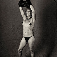 Rusty with pasties and slinky dress, Albuquerque, NM, 2012. by Jim Holbrook