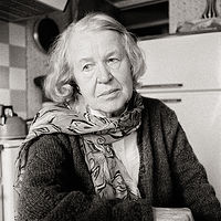 Anna Timofeyeva, Hero of the Gold Star of the Soviet Union, in her kitchen, Moscow, 1992. by Jim Holbrook