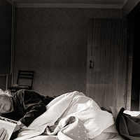 Anne Reading in Bed, Ryazan, Moscow, 1992 by Jim Holbrook