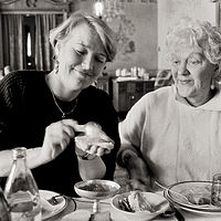 Anne Noggle and Rita Ponamaryova eating Caviar, Praga Restaurant, Moscow, 1992. by Jim Holbrook