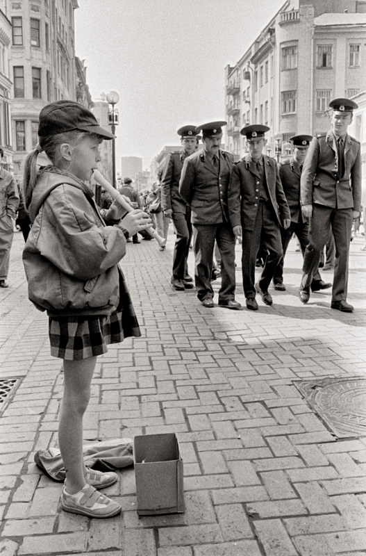 Girl with Flute, Red Square, Moscow, 1992. by Jim Holbrook