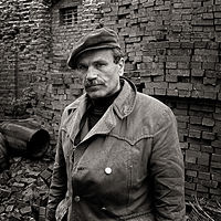 Photographer hiding his camera, Ryazan, Russia, 1992 by Jim Holbrook