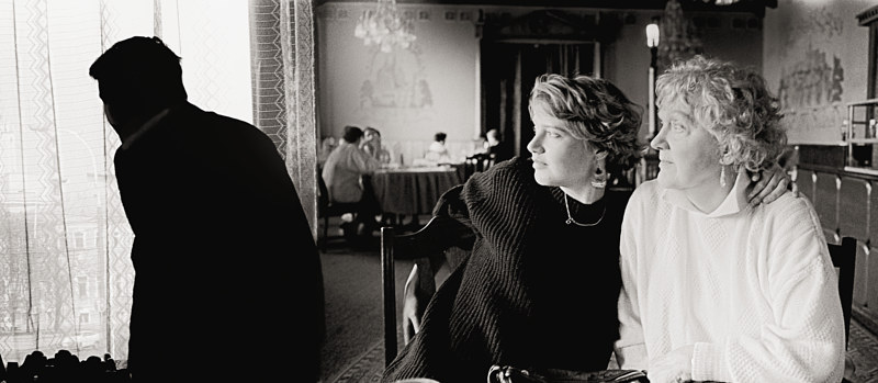 Rita with Anne at Praga Restaurant, Moscow, 1992 by Jim Holbrook