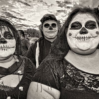 Three Skull Faces, South Valley Marigold Parade, Albuquerque, NM, 2011 by Jim Holbrook