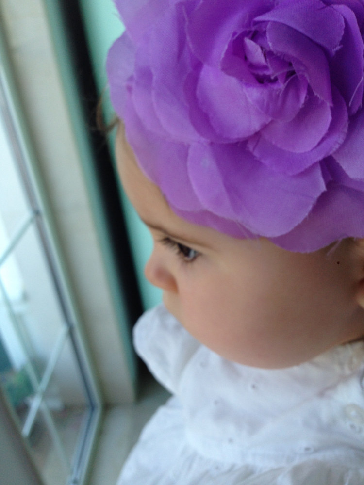 Violet wearing a violet headdress by Fiona Menzies
