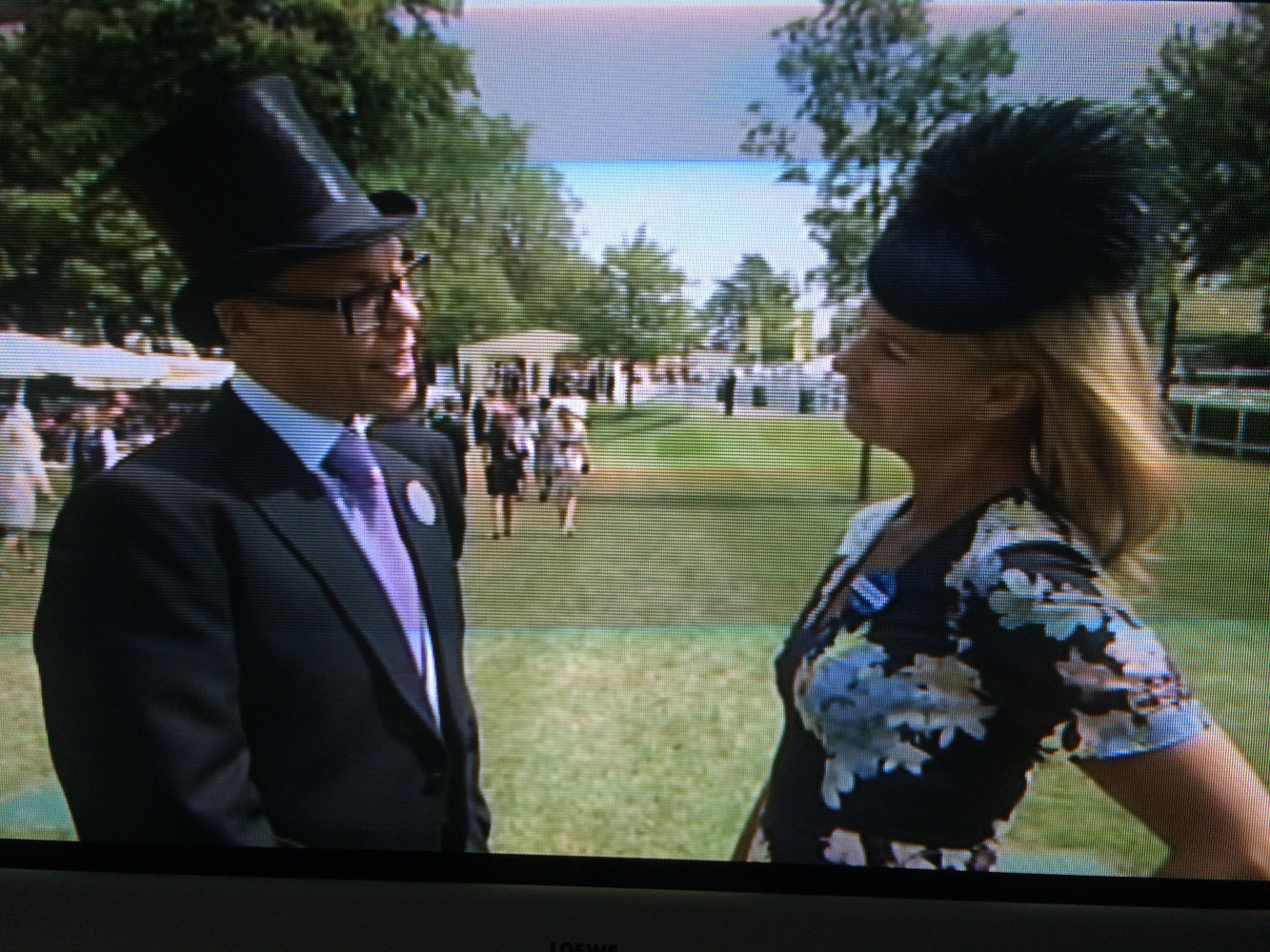 Gok interviewing Philippa in navy 'Betsy' at Royal Ascot  by Fiona Menzies