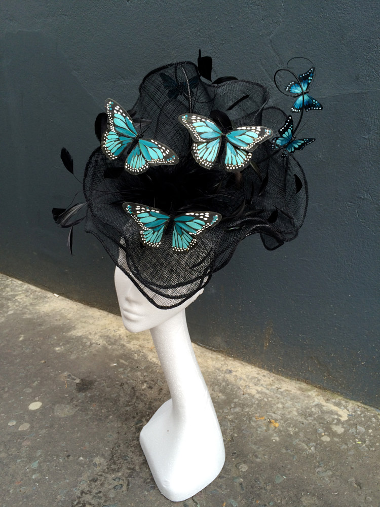 Hand shaped butterfly hat by Fiona Menzies