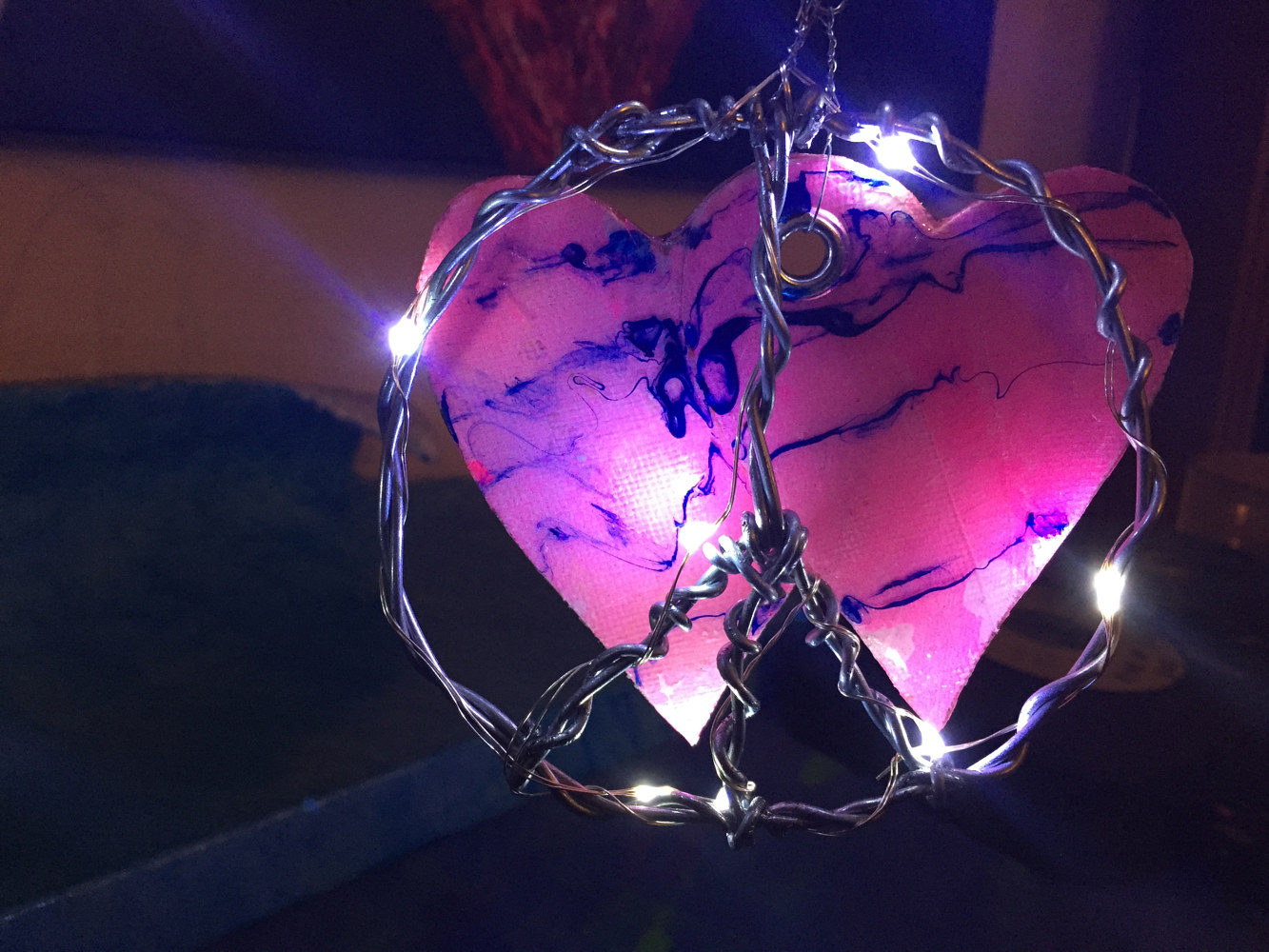 Fused Hearts and Peace Sign (detail with lights) by Steven Simmons