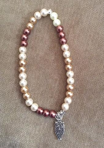 brown and white pearls with owl charm by June Long-schuman