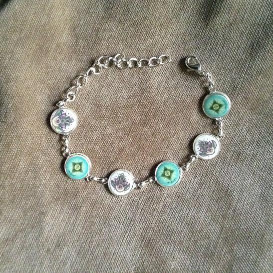 Painting Silver bracelet with faith,love, hope and slippa designs by June Long-schuman