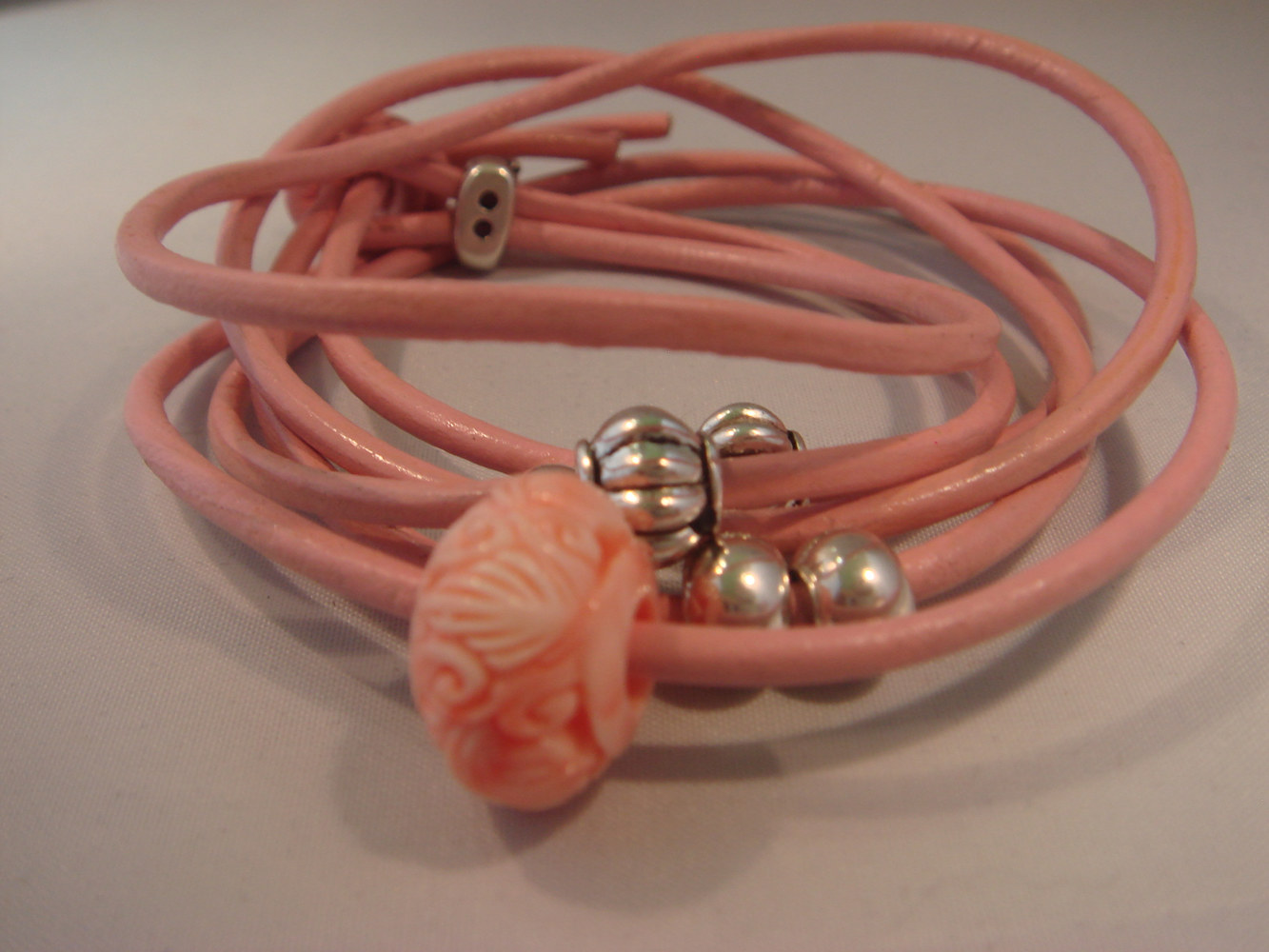 Drawing A Carved Pink Coral Bead on a Wrap aLeather Cord Bracelet by Renee Hennessy