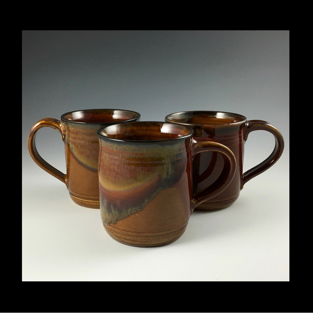 RED MUGS  by Elaine Clapper