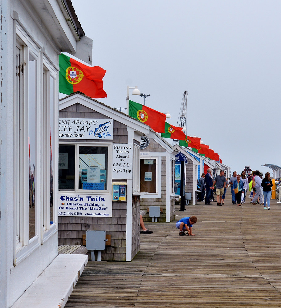 flags on the pier by Lisa Kane