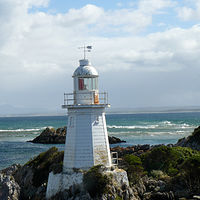 West Coast Tasmania  Sarah Island Lighthouse by Laurie Cochrane