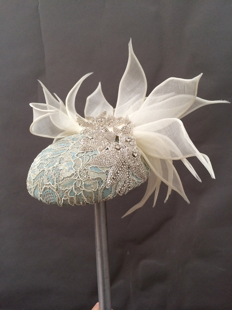 Lace and beaded spider cocktail hat by Fiona Menzies