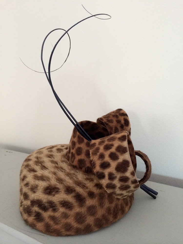 Cheetah fur felt pillbox with curls and quills by Fiona Menzies