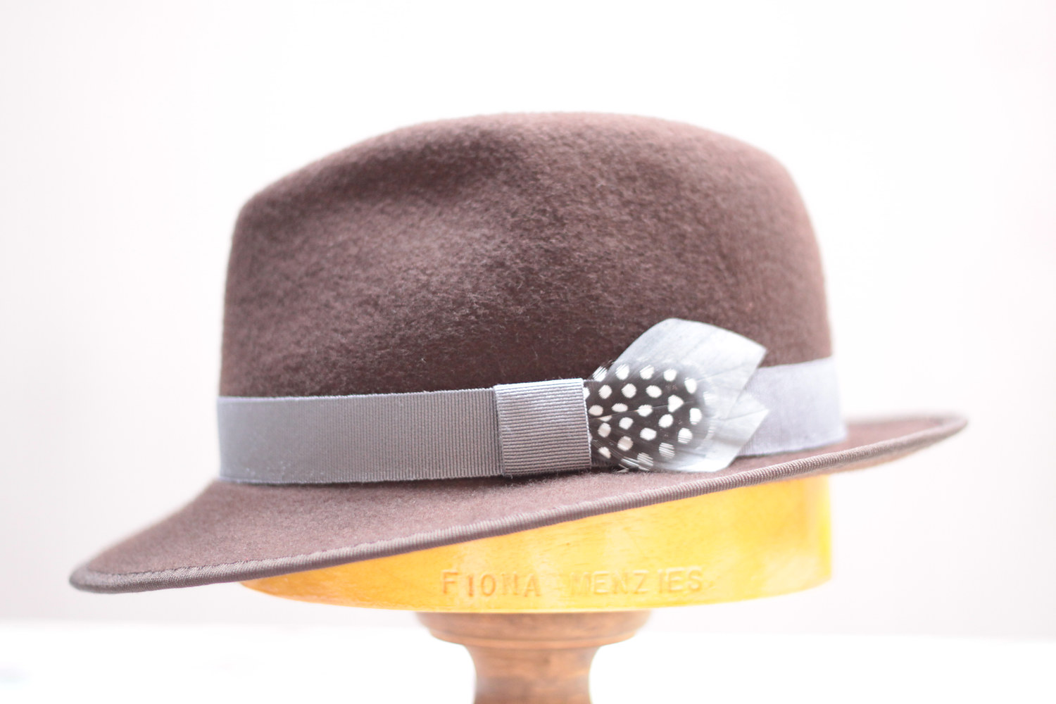 Chocolate brown felt trilby with grey skinny trim by Fiona Menzies