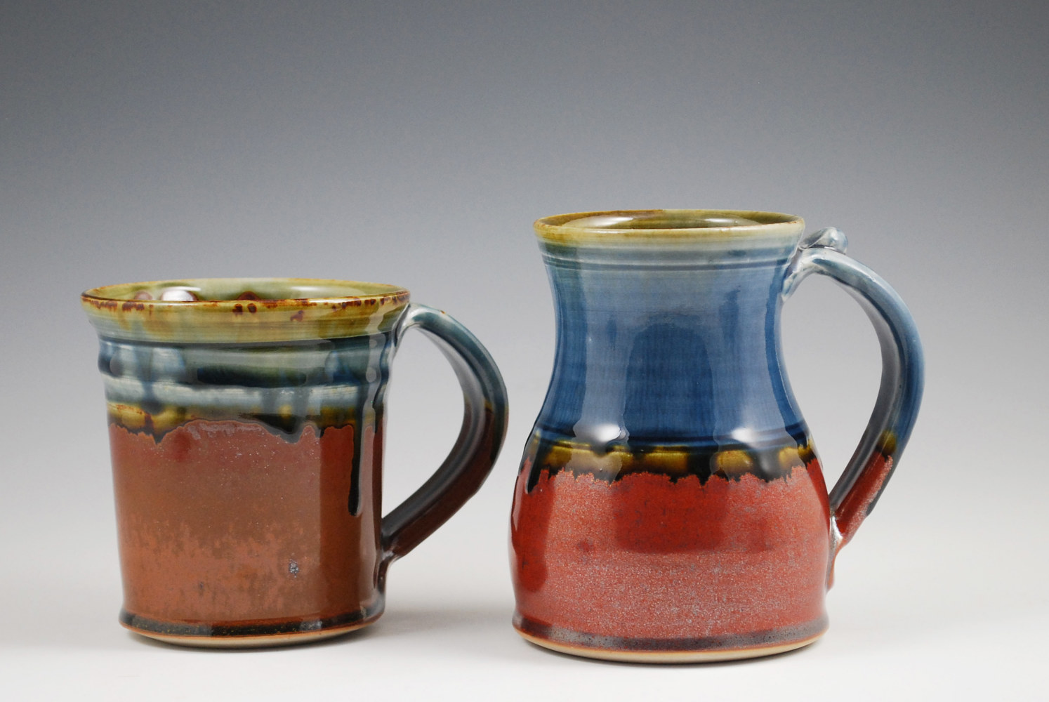 Blue Ash Straight Mug with Chocolate and Blue Ash Marks Mug with Rust Red by Mark  Goertzen