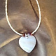 Shell heart pendant with assorted beads by June Long-schuman