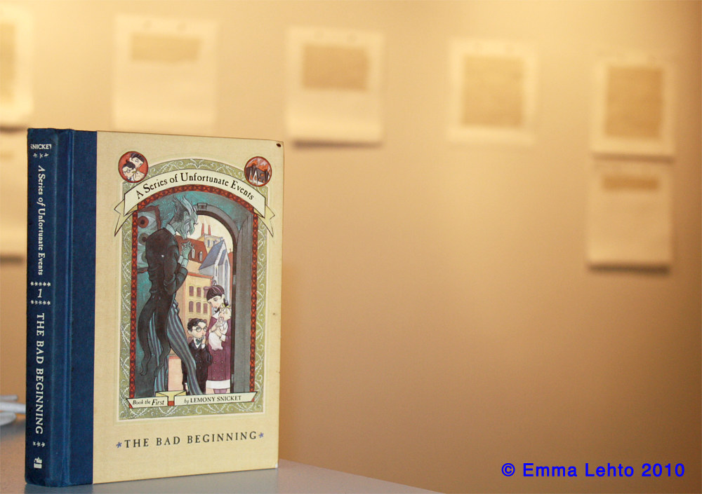 Book in Gallery space for Amended Series ( Snicket, Lemony, A Series of Unfortunate Events: A Bad Beginning New York: HarperCollins, 1999.) by Emma Lehto