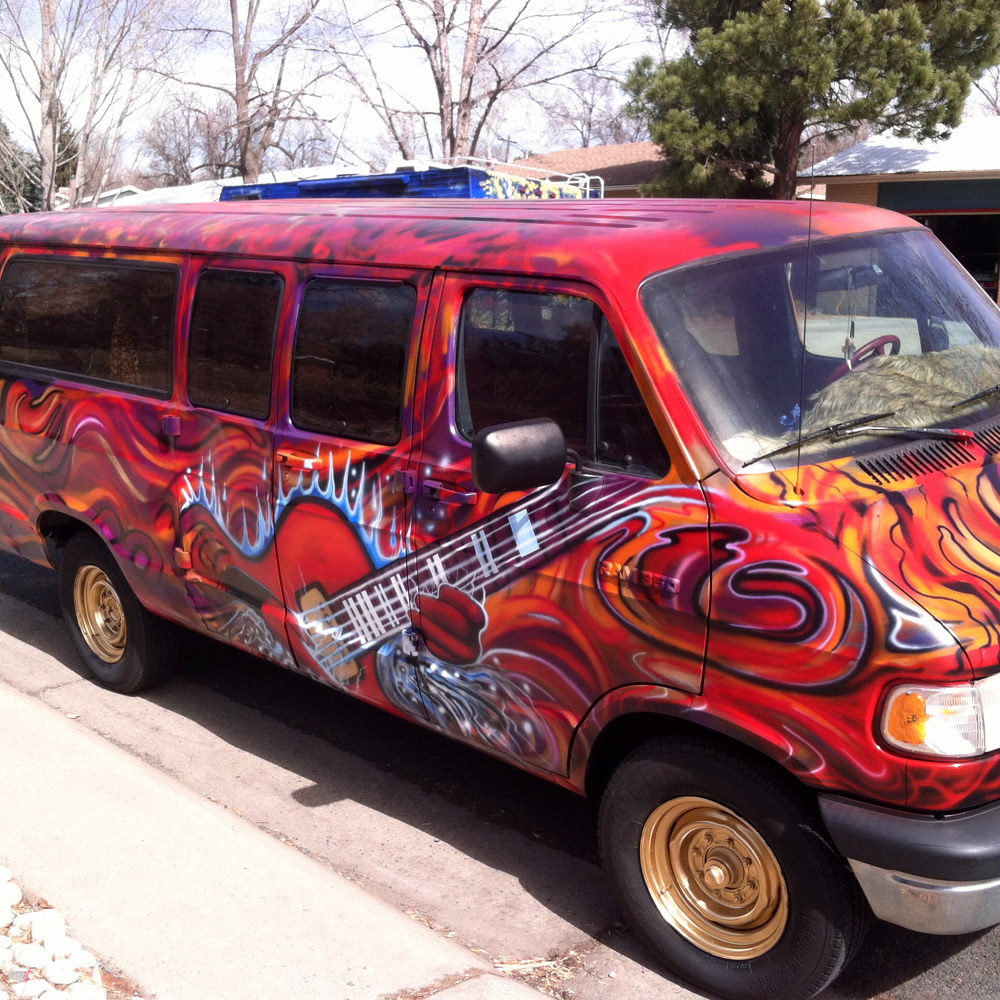 Red Guitar on Dodge Van by Isaac Carpenter
