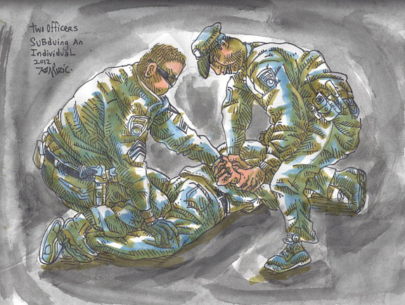 Two officers subduing an individual  by Kenneth M Ruzic