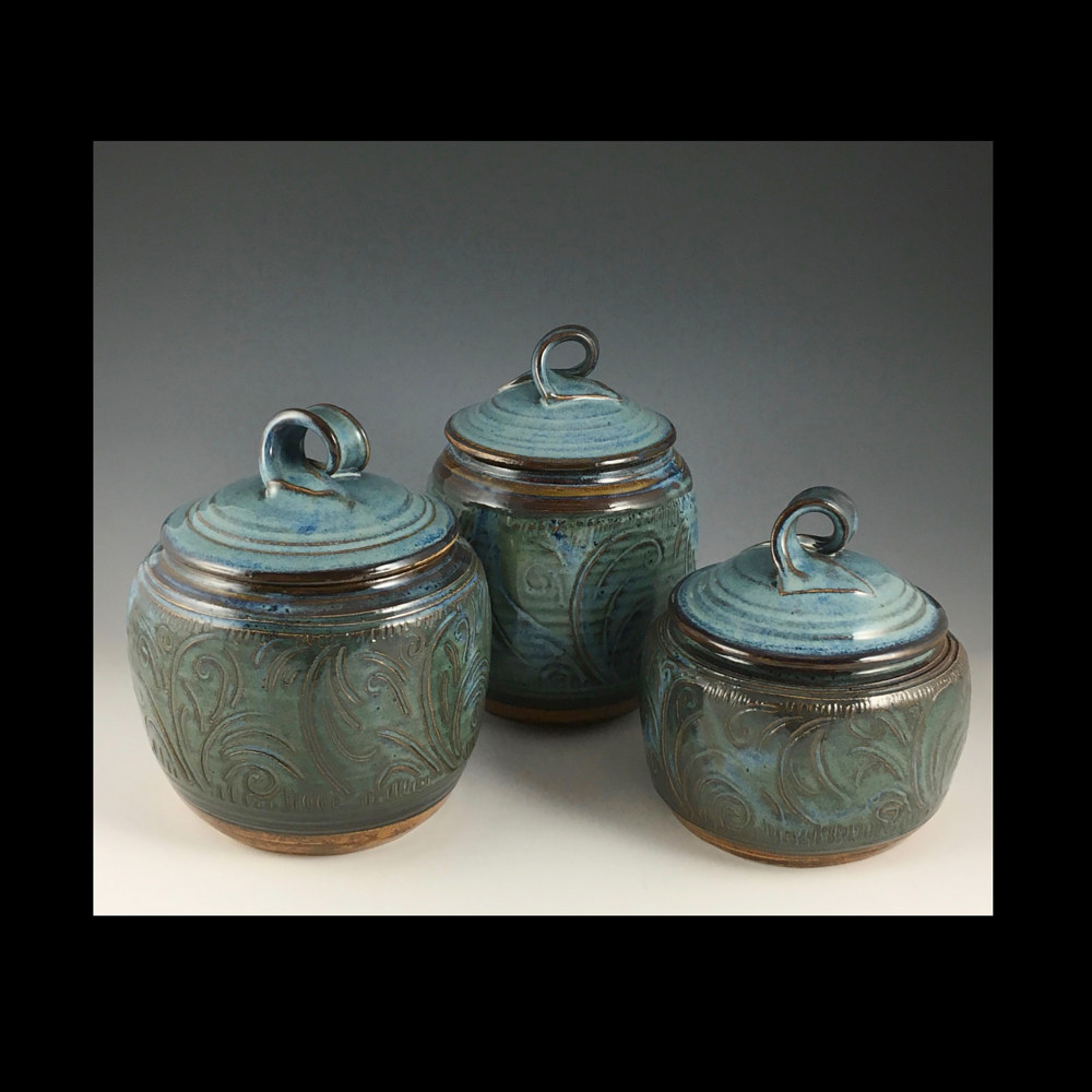 Three canisters blue series carved by Elaine Clapper