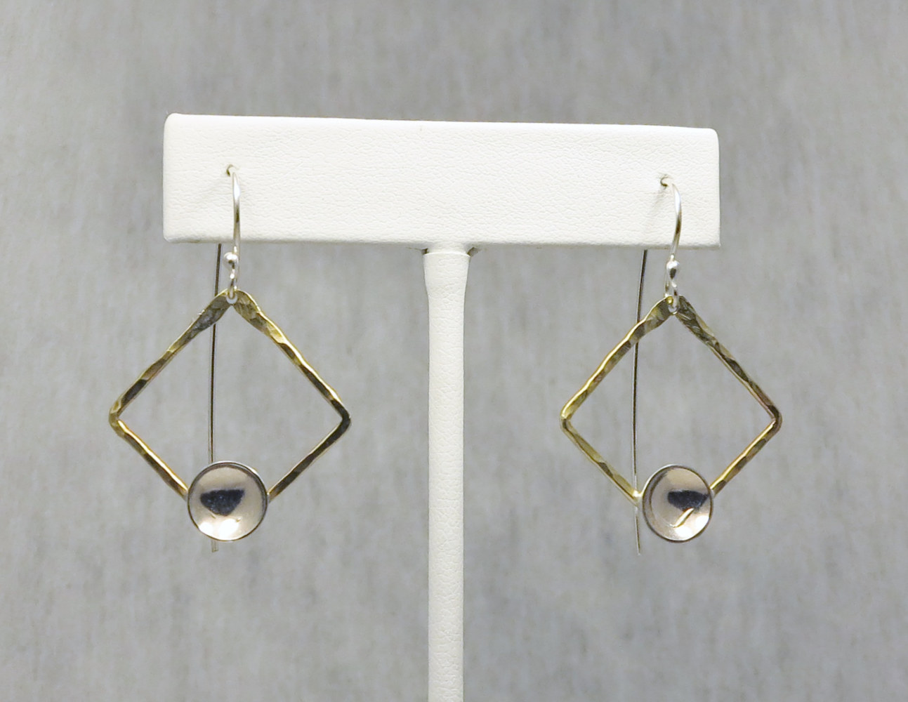 Brass and silver earrings by Vicki Allesia