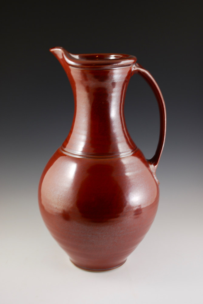 Rust Red Pitcher by Mark  Goertzen