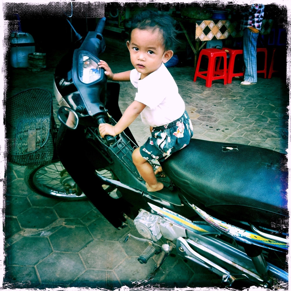 Boy in Siem Reap, Cambodia by Susan Raines