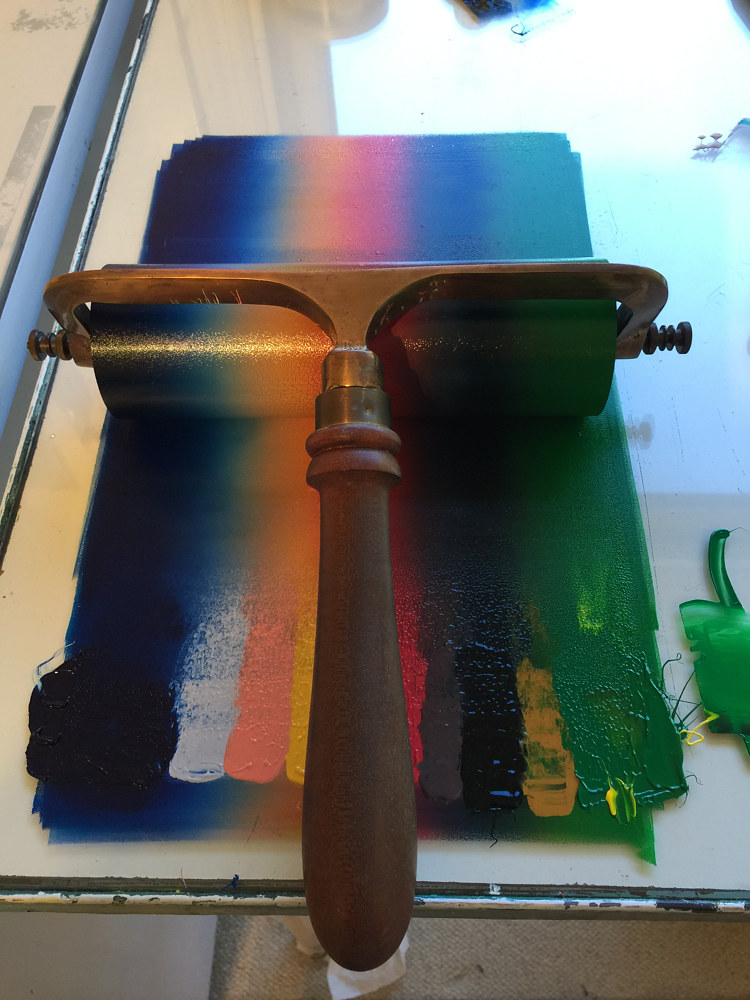 Inking up the brayer for first run. by Cathie Crawford