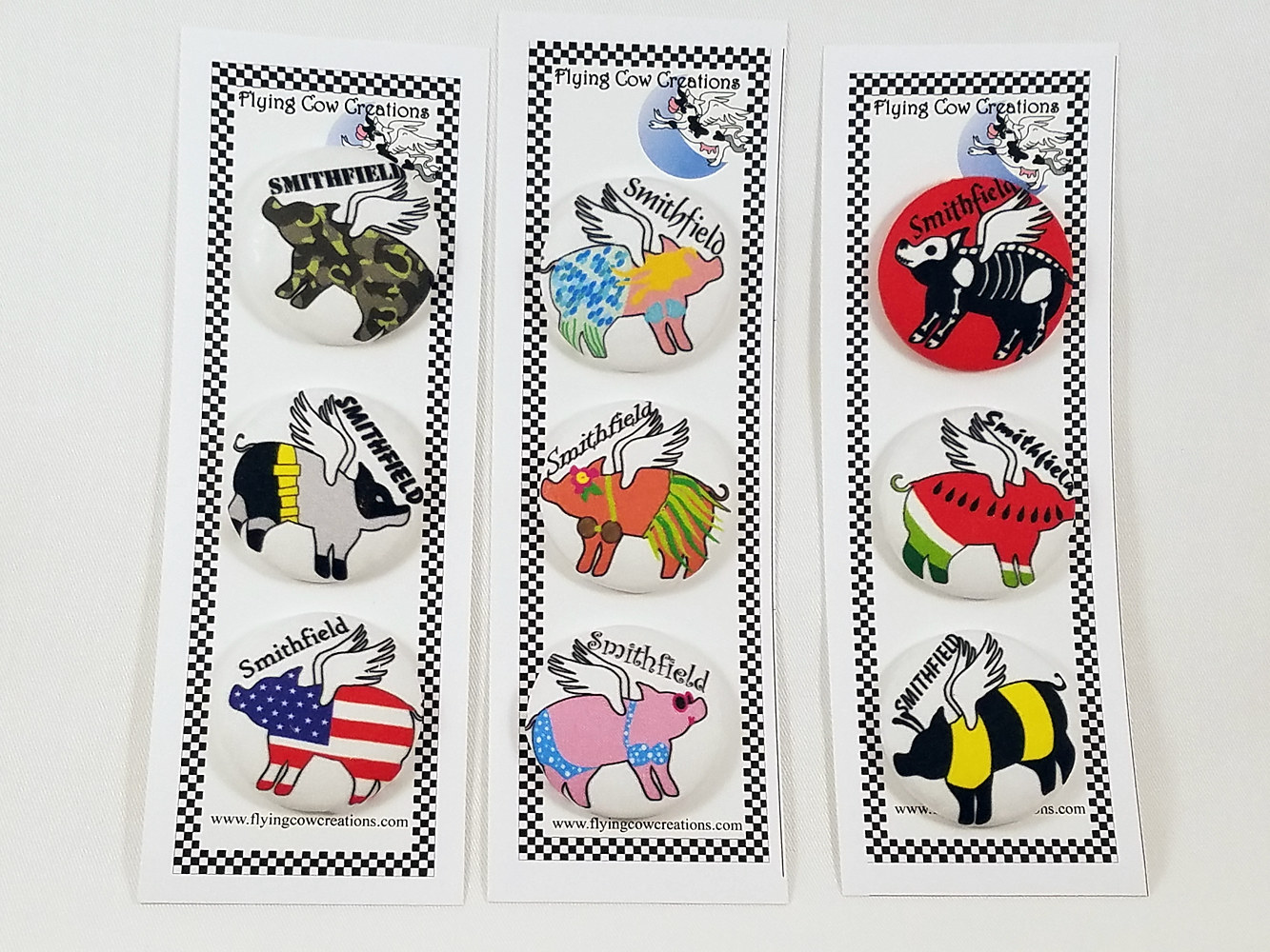 Flying pig covered buttons by Valerie Johnson