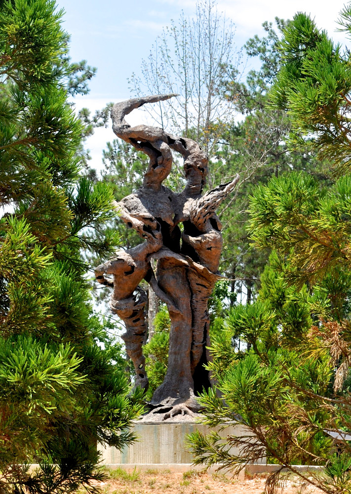 Rooted Family; 15 foot bronze, Atlanta by Jonathan  Hertzel