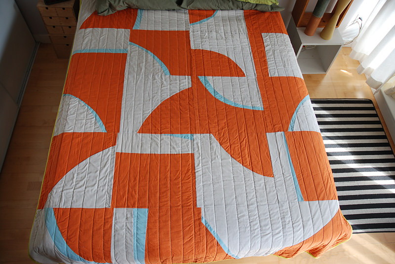 orange curves quilt by Stephanie Cormier
