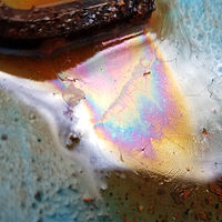 Photography Oil Slick in Water 2 by Jacqueline Bell johnson