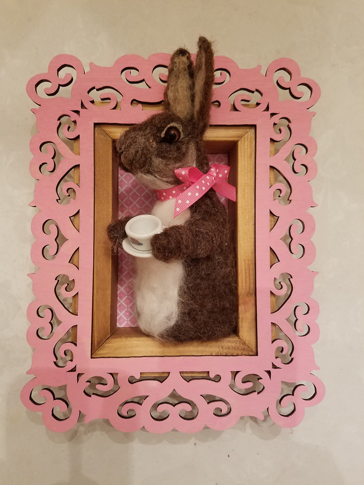 Sculpture Bunny having tea by Valerie Johnson