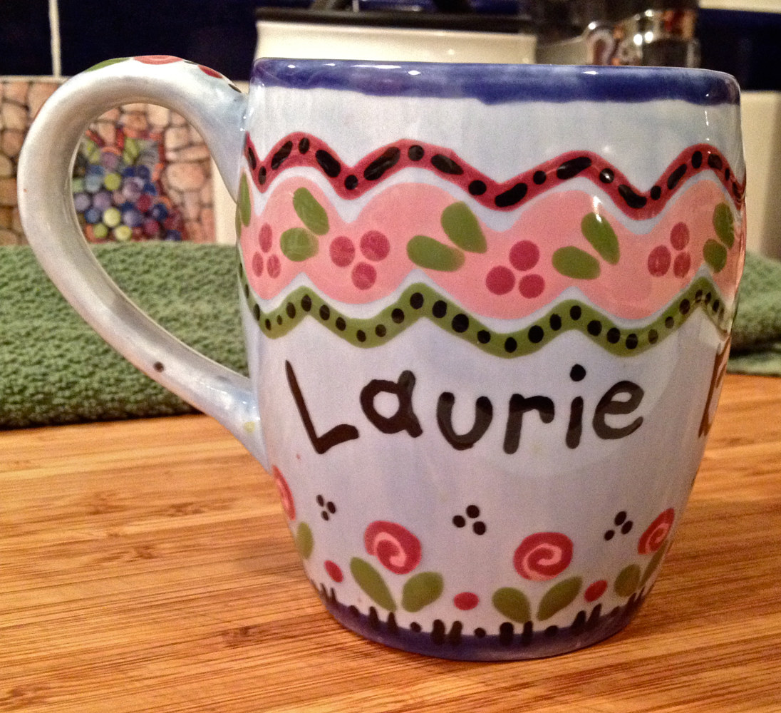"""Personalized Mug—Laurie"" (front) by Linnie (Victoria) Aikens Lindsay"