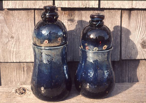 Blown and lidded jars by Gordon Sellen